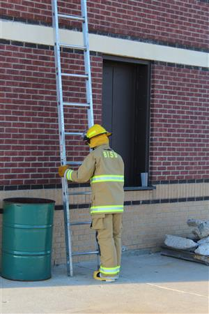 Firefighter Places Ladder