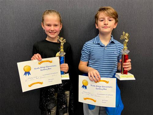 Olivia and Henry with spelling be trophies