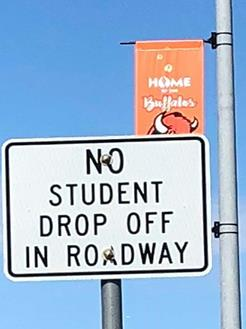 Sign stating no student drop off in roadway