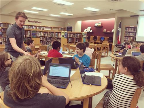 Nick Baker works with students on computer illustrations.